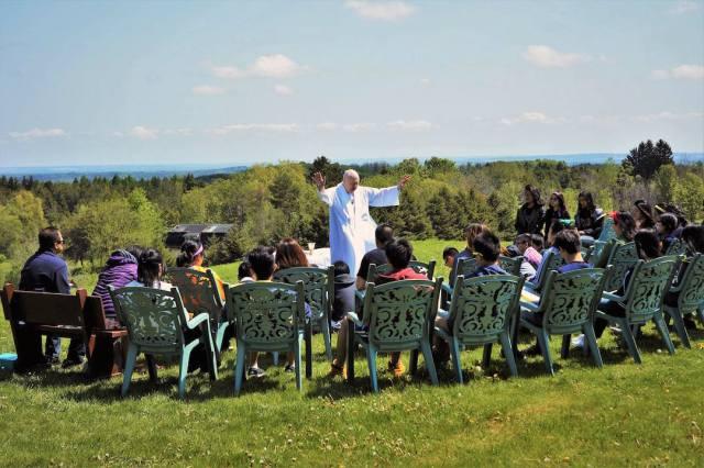 Fr. Peter McKenna leads an outdoor prayer service