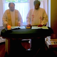 Fr. Aegi (right) during his installation in Toronto